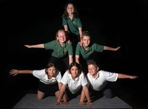 children performing acrobalance at  a circus workshop