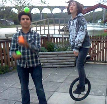 teenage boys juggling and uncicyling at a circus workshop
