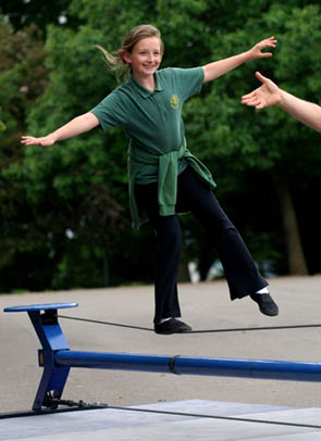 girl on tightwire at circus workshop